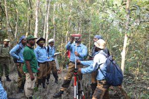 Setting DGPS rover into BFI plot center in Sundarbans