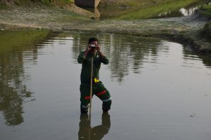 Bearing measurement from plot center within a pond using clinometer in Haor area, Hobigonj